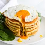 savory pancakes with fried eggs and spinach